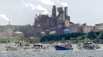 Fishing boats pass the Northern Pulp mill as concerned residents, fishermen and Indigenous groups protest the mill's plan to dump millions of litres of effluent daily into the Northumberland Strait in Pictou, N.S., on Friday, July 6, 2018. (THE CANADIAN PRESS / Andrew Vaughan)