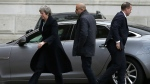 British Prime Minister Theresa May arrives at 10 Downing Street in London, Monday Dec. 10, 2018. (AP Photo/Tim Ireland)