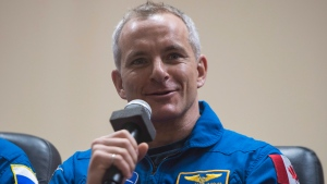 Expedition 58 Flight Engineer David Saint-Jacques answers a question during a press conference, Sunday, Dec. 2, 2018 at the Cosmonaut Hotel in Baikonur, Kazakhstan. Launch of the Soyuz rocket is scheduled for Dec. 3 and will carry Saint-Jacques, Flight Engineer Anne McClain of NASA, and Soyuz Commander Oleg Kononenko of Roscosmos, into orbit to begin their six and a half month mission on the International Space Station. (Aubrey Gemignani/NASA via AP)