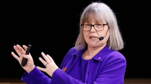"""The Nobel Prize laureate in Physics Donna Strickland of Canada speaks during her Nobel Lecture """"Generating High-Intensity Ultrashort Optical Pulses"""" at the Aula Magna, Stockholms University, Saturday, Dec. 8, 2018 in Stockholm. (Christine Olsson/TT News Agency via AP)"""