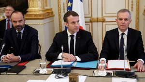 French President Emmanuel Macron, centre, French Prime Minister Edouard Philipppe, left, and Environment Minister Francois de Rugy meet with representatives of trade unions, employers' organizations and local elected officials at the Elysee Palace in Paris, Monday, Dec.10 2018. (Yoan Valat, Pool via AP)