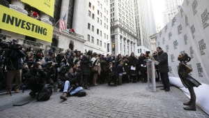 The Fearless Girl statue is unveiled at its new location in front of the New York Stock Exchange, on Dec. 10, 2018. (Mark Lennihan / AP)