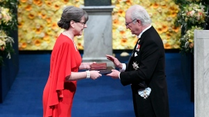 Physics laureate Donna Strickland, left, receives the prize from King Carl Gustaf of Sweden, during the Nobel Prize award ceremony, at the Stockholm Concert Hall, in Stockholm, Monday, Dec. 10, 2018. (Pontus Lundahl/Pool Photo via AP)