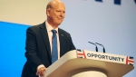 Britain's Secretary of State for Transport Chris Grayling addresses delegates during a speech at the Conservative Party Conference at the ICC, in Birmingham, England, Monday, Oct. 1, 2018. (AP Photo/Rui Vieira)