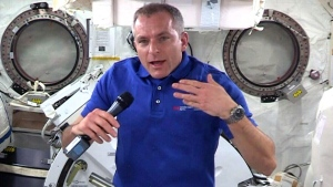 Canadian astronaut David Saint-Jacques takes questions from media at the International Space Station, Monday, Dec. 10, 2018.