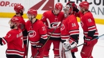 The Carolina Hurricanes celebrate their 4-1 win over the Anaheim Ducks in an NHL hockey game in Anaheim, Calif., Friday, Dec. 7, 2018. (AP Photo/Kyusung Gong)