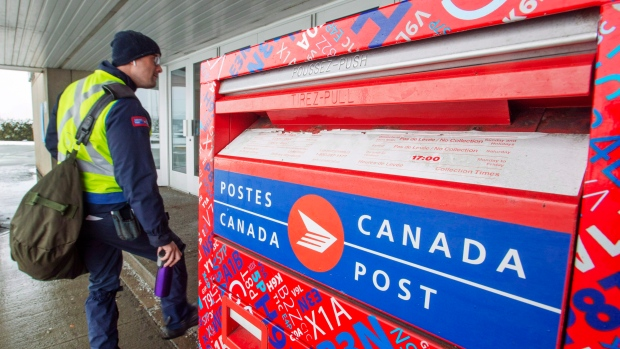 Canada Post workers return to work after the government ordered them to end their rotating strike Tuesday, November 27, 2018 in Montreal. THE CANADIAN PRESS/Ryan Remiorz