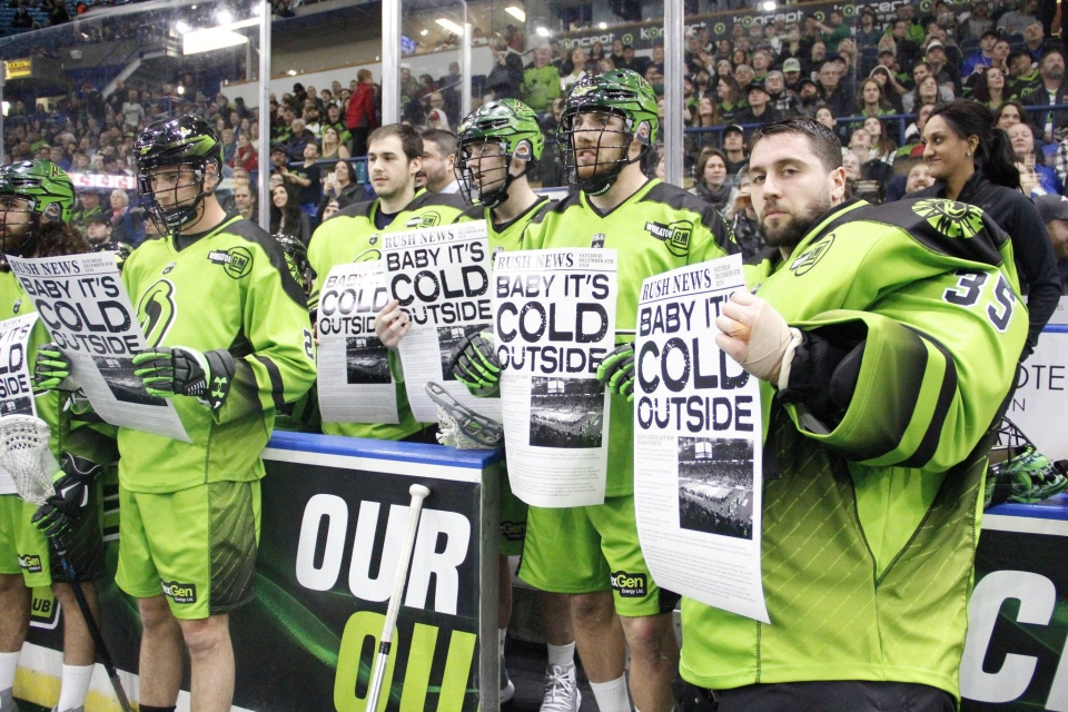 "Saskatchewan Rush players holding posters, made to look like newspapers, to poke fun at the ""Baby It's Cold Outside"" controversy (Courtesy: Facebook)."