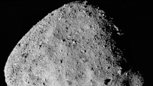 This mosaic image composed of 12 PolyCam images collected on Dec. 2, 2018, and provided by NASA shows the asteroid Bennu. The tiny asteroid regularly crosses Earth's orbit and will come perilously close to Earth in about 150 years. (NASA/Goddard/University of Arizona via AP)