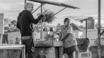 """This image released by Netflix shows filmmaker Alfonso Cuaron, left, and actress Yalitza Aparicio on the set of """"Roma."""" (Carlos Somonte/Netflix via AP)"""