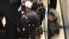An image from a video posted to Facebook shows police officers taking a baby from a mother's arms at a public benefits office in New York City. (Facebook / Nyashia Ferguson)