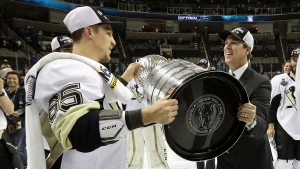 Pittsburgh Penguins defenceman Steven Oleksy (65) hands the Stanley Cup to head coach Mike Sullivan after Game 6 of the NHL hockey Stanley Cup Finals against the San Jose Sharks in San Jose, Calif., Sunday, June 12, 2016. THE CANADIAN PRESS/AP-Bruce Bennett/Getty Images via AP, Pool