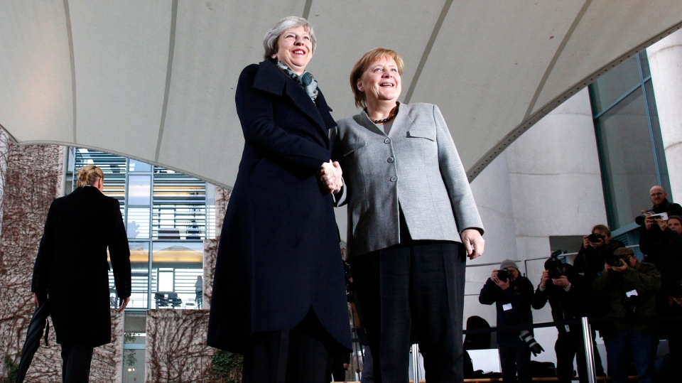 German Chancellor Angela Merkel, right, welcomes British Prime Minister Theresa May prior to a meeting in the chancellery in Berlin, Germany, Tuesday, Dec. 11, 2018. (AP Photo/Michael Sohn)