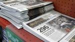 In this file photo, stacks of the Star Tribune of Minneapolis sit on a store shelf Monday, Monday, Nov. 5, 2007 in suburban Bloomington, Minn. (AP Photo/Jim Mone)