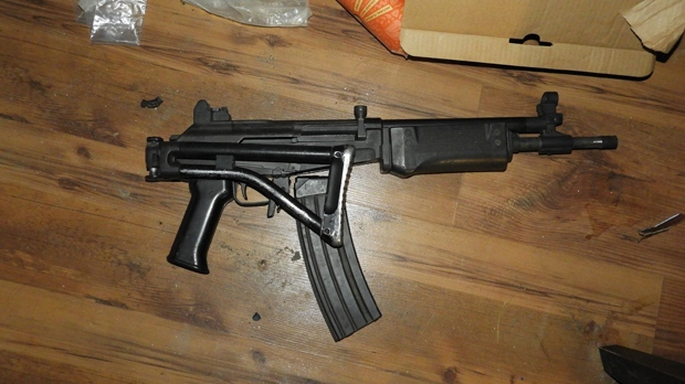 A compact IMI Galil assault rifle is shown in a handout image from the OPP.