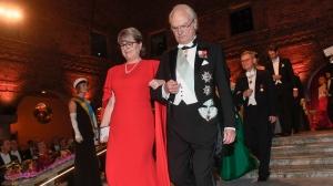 Physics 2018 Nobel laureate Donna Strickland and King Carl Gustaf of Sweden arrive for the Nobel Prize banquet in Stockholm City Hall, Sweden, Monday Dec. 10, 2018. (Fredrik Sandberg/TT via AP)