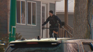 Police and crisis negotiators are surrounding a home on Avenue K North after people have barricaded themselves inside the home. (Dale Cooper/CTV Saskatoon)