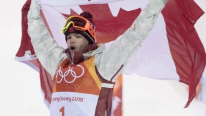 Canadian Mikael Kingsbury celebrates winning his gold medal at the moguls finals at the Phoenix Snow Park at the Pyeongchang 2018 Winter Olympic Games in South Korea, Monday, Feb. 12, 2018. (THE CANADIAN PRESS / Jonathan Hayward)