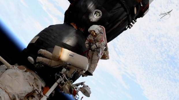 Russian spacewalkers carve away at Soyuz spaceship to inspect plugged hole
