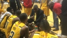 Keith Vassell, center, talks to players during the London Lightning home opener of the 2017-18 season in London, Ont. (Brent Lale / CTV London)