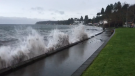 Waves slam a seawall in Qualicum Beach, B.C. Dec. 11, 2018. (Twitter/@Dashwood6)