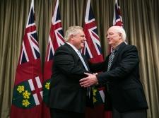 Oro-Medonte Mayor Harry Hughes shakes hands with Ontario Premier Doug Ford on Monday December 11, 2018