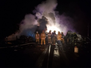 Firefighters on the scene of a crash on Hwy 11