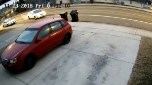 Surveillance camera still of a woman driving off in Fahad Mohammad's 2012 Honda Civic on November 23, 2018