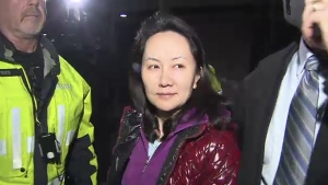 Huawei executive Meng Wanzhou leaves the B.C. Supreme Court in Vancouver, B.C., after being granted bail on Tuesday, Dec. 11, 2018