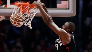 Toronto Raptors' Serge Ibaka (9) dunks against the Los Angeles Clippers during the second half of an NBA basketball game, Tuesday, Dec. 11, 2018, in Los Angeles. (AP Photo/Marcio Jose Sanchez)
