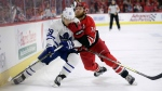 Toronto Maple Leafs' William Nylander (29) and Carolina Hurricanes' Jaccob Slavin (74) chase the puck during the first period of an NHL hockey game in Raleigh, N.C., Tuesday, Dec. 11, 2018. (AP Photo/Gerry Broome)
