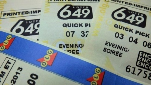Lotto 649 tickets are shown in Toronto in on December 2, 2013. THE CANADIAN PRESS/Richard Plume