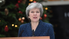 Britain's Prime Minister Theresa May makes a media statement in Downing Street, London, confirming there will be a vote of confidence in her leadership of the Conservative Party, Wednesday Dec. 12, 2018. The vote of confidence will be held in Parliament Wednesday evening, with the result expected to be announced soon after. (Stefan Rousseau/PA via AP)