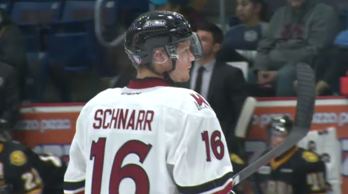 Guelph Storm forward Nate Schnarr awaits offensive zone face-off.