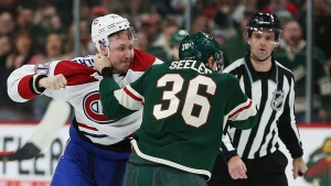 Minnesota Wild's Nick Seeler fights with Montreal Canadiens' Nicolas Deslauriers in the second period of an NHL hockey game, Tuesday, Dec. 11, 2018, in St. Paul, Minn. (AP Photo/Stacy Bengs)