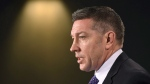 Former NHL player and child advocate Sheldon Kennedy speaks during a press conference on Parliament Hill in Ottawa on Monday, Feb. 5, 2018.THE CANADIAN PRESS/Justin Tang