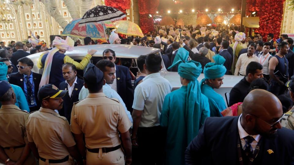 The car carrying the groom Anand Piramal arrives at the house of Mukesh Ambani in Mumbai, India, Wednesday, Dec. 12, 2018.(AP Photo/Rajanish Kakade)