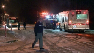 Authorities examine the scene of a deadly bus crash in Boucherville (CTV Montreal/Cosmo Santamaria)
