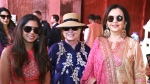 In this Sunday, Dec. 9, 2018 handout photo released by Reliance Industries Limited, former U.S. Secretary of State Hillary Clinton stands and Nita Ambani, right, visit a curated showcase of traditional Indian crafts and art forms on display ahead of the wedding of Isha Ambani, left, in Udaipur, India. (Reliance Industries Limited via AP)