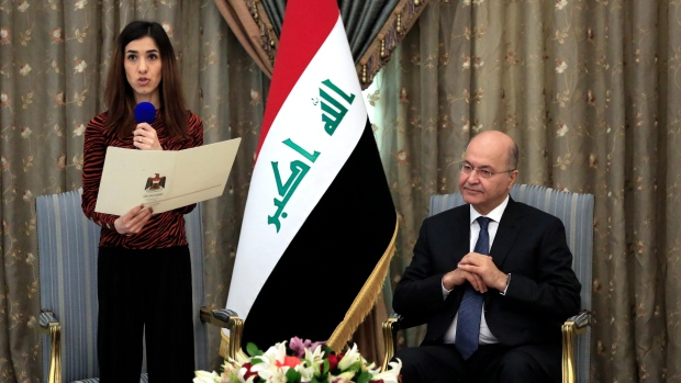 Nobel laureate returns to Iraq, pledges to work for peace