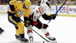 Nashville Predators defenseman Dan Hamhuis (5) and Ottawa Senators left wing Brady Tkachuk (7) fight for the puck in the first period of an NHL hockey game Tuesday, Dec. 11, 2018, in Nashville, Tenn. (AP Photo/Mark Humphrey)