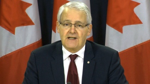 Transportation Minister Marc Garneau addresses pilot fatigue during a press conference in Ottawa, Wednesday, Dec. 12, 2018.