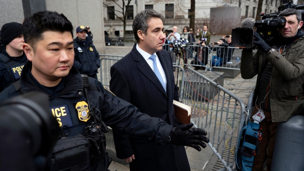 Michael Cohen, U.S. President Donald Trump's former lawyer, leaves federal court after his sentencing in New York, Wednesday, Dec. 12, 2018. (AP Photo/Craig Ruttle)