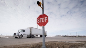 The stop sign on highway 335 is seen at the intersection of highway 35 near Tisdale, Sask., Tuesday, April, 10, 2018. THE CANADIAN PRESS/Jonathan Hayward