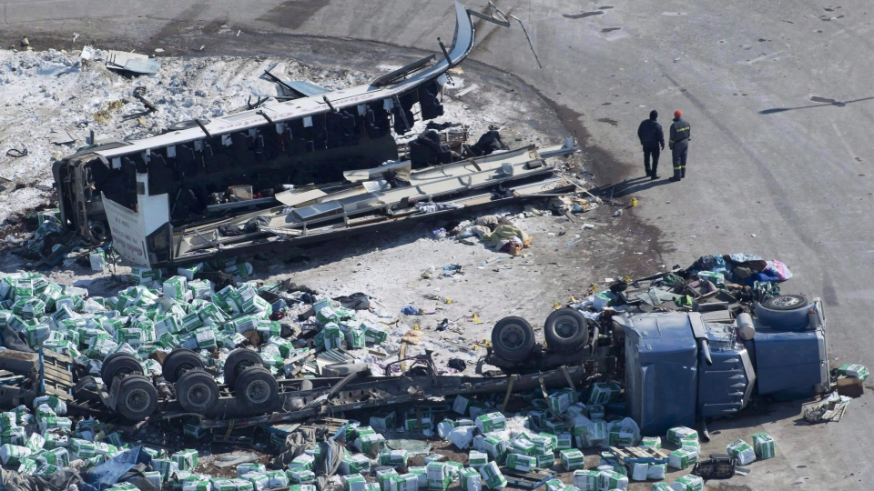 The wreckage of a fatal bus crash carrying members of the Humboldt Broncos hockey team is shown outside of Tisdale, Sask., on April, 7, 2018. THE CANADIAN PRESS/Jonathan Hayward