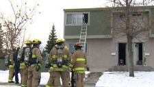Woman rescued from northeast house fire