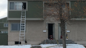 Fire crews rescued a woman from the second floor of the townhouse after she became trapped.