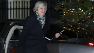British Prime Minister Theresa May arrives at 10 Downing Street, in London, Wednesday, Dec. 12, 2018. (AP Photo/Tim Ireland)
