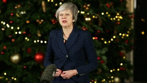 British Prime Minister Theresa May walks from 10 Downing Street to make a statement, in London, Wednesday December 12, 2018. British Prime Minister Theresa May survived a brush with political mortality Wednesday, winning a no-confidence vote of her Conservative lawmakers that would have ended her leadership of party and country (AP Photo/Tim Ireland)