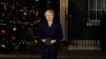 Britain's Prime Minister Theresa May delivers a speech outside 10 Downing Street in London, Wednesday, Dec. 12, 2018. British Prime Minister Theresa May survived a brush with political mortality Wednesday, winning a no-confidence vote of her Conservative lawmakers that would have ended her leadership of party and country. (AP Photo/Matt Dunham)